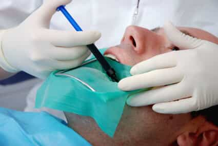Man undergoing a root canal procedure